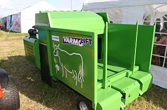 En grønn fôrutlegger i teltveggen